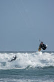 Kite Surfers Riding and Jumping Royalty Free Stock Photography