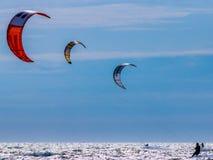 3 kite surfers on the sea. Three kite surfers on the sea Stock Photos