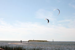 Kite-surfers at seaside Stock Photography