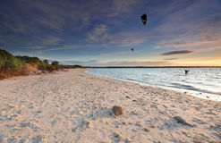 Kite Surfers at sunset on Silver Beach, Botany Bay Australia Stock Photos