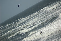 Kite Surfing 1. A kite surfer jumps a wave Royalty Free Stock Image