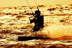 Kite surfing. Sunset kite surfing at night royalty free stock images