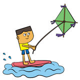 Kite surfing. A young man surfing while being pulled by a flying kite Stock Photos