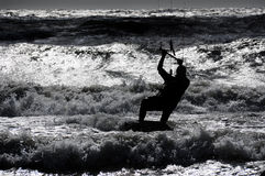 Kite surfing. Kite boarder action with sunset Royalty Free Stock Photography