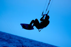 Kite surfing. Silhouette of sportsmen on blue Stock Images