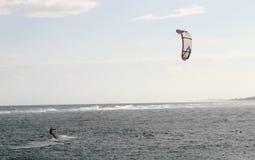 Kite Surfing. A man kite surfing off Jupiter Beach, in Florida, USA Royalty Free Stock Image