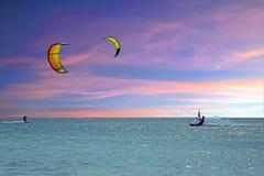 Kite surfing at Aruba island at sunset. Kite surfing at Aruba island in the caribbean sea at sunset Royalty Free Stock Photo