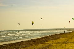 Kite surfing Gliding up and down with their surf boards, Kite Surfing on the coastal waves royalty free stock photos