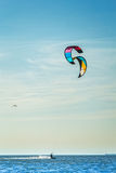 Kite-surfing on the background of blue sea Royalty Free Stock Images