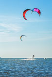 Kite-surfing on the background of sea and sky Stock Photos