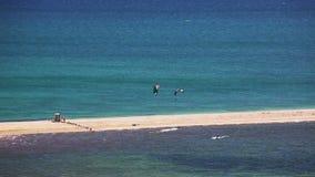 Kite surfing on blue sea surface stock footage