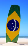 Kite surfing in brazil. Brazilian flag painted on a kite surf board with praia e vento (beach and wind) instead of ordem e progresso  in prainha beach near Stock Images
