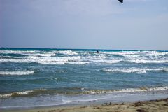 Kite Surfing extreme sports out in the Mediterranean Sea, Cyprus royalty free stock photo