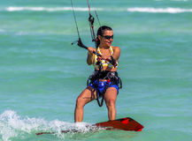Kite-surfing girl. Close-up of a young woman kitesurfer riding in greenish-blue sea Stock Images