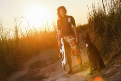 Kite Surfing Girl With The Dog Stock Photos