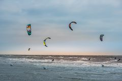Kite surfing competition on waves stock photos