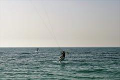 Kite Surfing. Kiteboard,. Kite surfing on a beach in Dubai Stock Photos