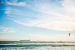 Kite surfing. Man surfing in atlantic ocean on water kite during sundown in cape town Stock Images