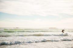 Kite surfing. Man surfing in atlantic ocean on water kite during sundown in cape town Royalty Free Stock Image