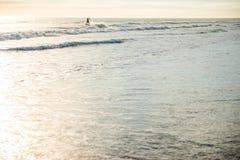 Kite surfing. Man surfing in atlantic ocean on water kite during sundown in cape town Stock Photo