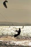 Kite surfing. Man doing kite surfing or kiteboarding Stock Photography