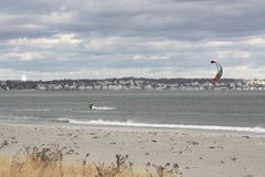 Kite Surfing. With 50 mile per hour wind gust this kite surfer off the coast of Nahant Massachusetts was catching some great rides royalty free stock photography