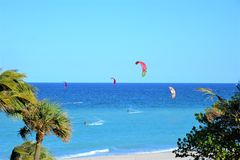 Kite Surfing is popular off the Boca Raton, Florida Beach. The Boca Raton, Florida Beach has plenty of windy shoreline offering Kite Surfers miles of coastline Royalty Free Stock Photography