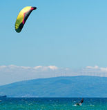 Kite surfing on a pristine beach Royalty Free Stock Images