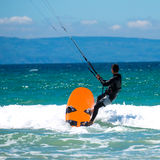 Kite surfing on a pristine beach Stock Photos