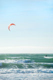 Kite Surfing in San Francisco. Surfer with red kite surfing off the beach in San Francisco, California on a sunny day Royalty Free Stock Photo