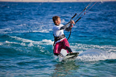 Kite surfing on the sea. Royalty Free Stock Image