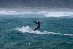 Kite Surfing Sodwana Bay. A kite surfer in Sodwana Bay, South Africa navigates the water Royalty Free Stock Photography