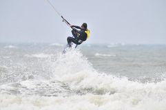 Kite surfing in spray. Royalty Free Stock Photo