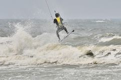Kite surfing in spray. Surfer going kite surfing, surfboard splashes bursts of spray Royalty Free Stock Image