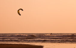 Kite surfing at sunset Royalty Free Stock Image