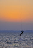 Kite surfing at sunset Stock Photography