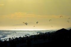 Kite surfing at sunset Royalty Free Stock Photo