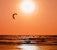 Kite surfing at sunset Royalty Free Stock Photos