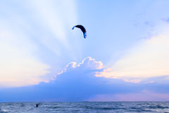 Kite-surfing at the sunset Stock Image