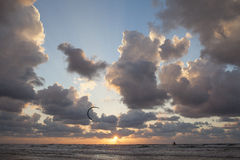 Kite surfing .Sunset at sea. The sun at sunset in the summer royalty free stock photo
