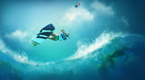 Kite surfing. Kite surfer jumping over a wave Royalty Free Stock Photo