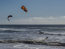 Kite surfing. A kite surfer navigates the waves on the Pacific Ocean in California royalty free stock photo