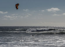 Kite surfing. A kite surfer navigates the waves on the Pacific Ocean in California stock photo