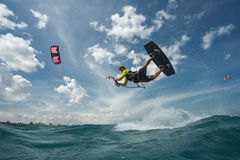 Kite surfing. A kite surfer rides the waves Stock Photos