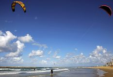 Kite Surfing on Tel Aviv Beach. A couple of Kite surfers on the Tel Aviv beach on a lovely breezy day in December Stock Photos