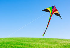 Kite with tail in clear blue sky Stock Photos
