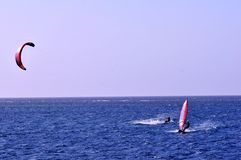 Kite, Windsurfer and Ocean. Windsurfer and kite surfer on the ocean with kite in sky Stock Photography