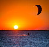 Kiteboard. Silhouette a Kiteboard at sunset Royalty Free Stock Photography