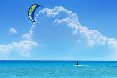 Kiteboarder. With blue - yellow kite Stock Photography
