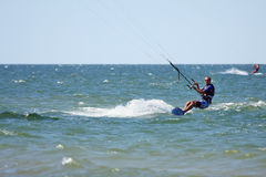 Kiteboarder. Surfing waves with kiteboard Stock Photography